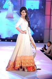 Actress Priyanka Chopra wearing a design by designer Manish Malhotra at CPAA charity Fashion Show in July 2012