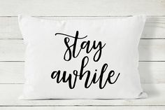 Welcome your guests with this Stay Awhile pillow cover from Cozy Home Studio.