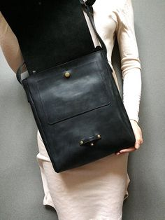 This messenger bag is made of full grain black leather. This leather feels like vintage a bit and is not glossy at all. All small marks and scratches will be seen on this leather which brings the bag more of retro look. But it adds some character to it. The bag was genuinely created for