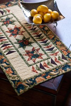 Elegant runner by Terry Albers in Fons & Porter's Easy Quilts Fall 2012. Fabrics are from Autumn Flare by Thimbleberries.