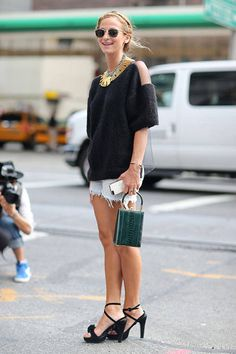 Shop this look on Lookastic:  https://lookastic.com/women/looks/crew-neck-sweater-shorts-heeled-sandals-clutch-sunglasses-necklace/2569  — Gold Necklace  — Black Leather Heeled Sandals  — Dark Green Clutch  — White Denim Shorts  — Black Crew-neck Sweater  — Black Sunglasses