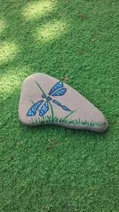 Dragonfly painted on a Lake Huron beach stone by Cindy P 2017