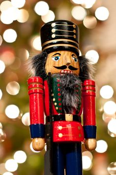 """Nutcracker"" by Brian Guest (giant rebus) on Flickr - a photograph of a nutcracker standing in front of a Christmas tree."