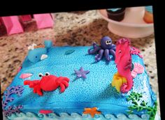 """This is Collins's Birthday cake. The cake is a 1/4 sheet from the bakery store, covered in blue buttercream frosting. I made all the """"under the sea"""" decorations with fondant and Wilton's Shape-And-Amaze."""