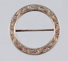 Silver circle pin