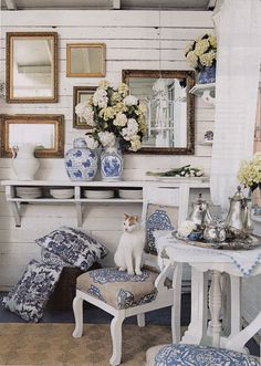 "Kitty ""China"" enjoys a perch on the front porch that showcases Manual Canovas fabrics"