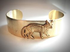 this makes me howl... Wolf Canidea Brass Cuff Bracelet from JewelryByMaeBee on Etsy. $24