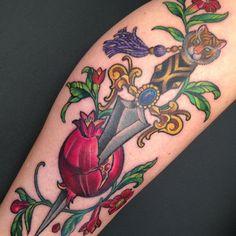 Tiger dagger through a pomegranate tattoo by Kim Saigh at Memoir Tattoo