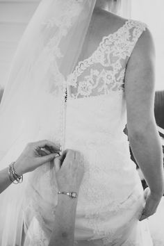 Mum doing up the buttons on my lace dress- Justin Alexander 8530