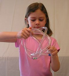Untie and make a whole new configuration - will definitely keep you occupied! A great activity for bilateral coordination, motor planning and visual tracking.