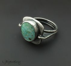 Sterling silver ring with burtis blue turquoise