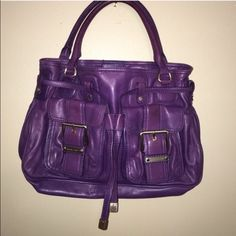 MICHAEL KORS PURSE This MK Authentic purse is a beautiful color purple!! A medium size purse with 2 small pockets in front and lots of room inside. It is in good used condition with minimal wear outside and inside is like new. Hardware is not gold more like a gunmetal silver. Michael Kors Bags Shoulder Bags