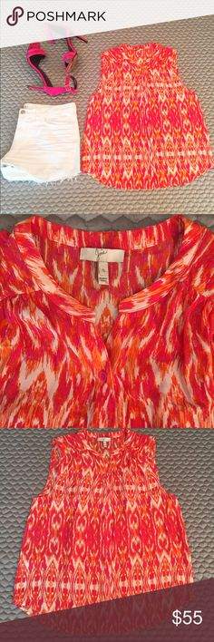 Joie Ikat Button Down! This adorable pink, hot coral, white, and orange button down is ideal to give a pop of color to your white denim this summer. This top is in good (preowned) condition. Please note that the item does have a few nearly unnoticeable stains on the back left shoulder (see final picture) and it is very possible that this will come out with cleaning. Joie Tops