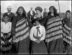 Photograph of a group of Maori women, with a boy standing on either side of the group; some of the women are wearing traditional Maori clothing (pi. Polynesian People, Maori People, Maori Art, New Zealand, Portrait, News, Group, Image, Women