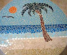 Mosaic Palm Tree Beach: This was my very first piece. It started out on the top of a rope spool, but ended up being on iron legs. It is 23 in diameter. I drew the design