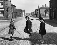 Three Girls Skipping in the Middle of a Manchester Street Photographic Print by Shirley Baker Goldscheider, White Photography, Street Photography, Photography Women, Old Photos, Vintage Photos, Vintage Photographs, Shirley Baker, Manchester Street
