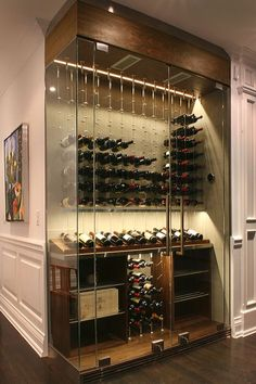 A beautiful reach-in wine cellar by Papro Consulting Ltd. featuring the Cable Wine System www.cablewinesystems.com #WineCellar