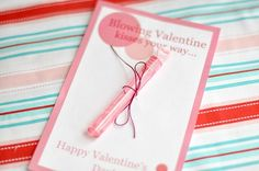 """""""Blowing Valentine Kisses your way"""" Girl DIY Valentine with lip gloss.  DIY Kids Valentine Cards - 7 on a Shoestring"""