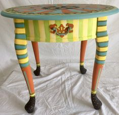 Hand painted accent table available at Curiousartco