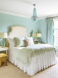 Tranquil Turquoise  Soft turquoise and mint throughout this master bedroom create a cohesive color palette. Accented on the walls and again on the glass chandelier, the pretty palette is ideal for tranquility and relaxation.