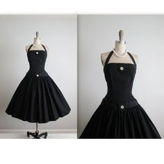 Gorgeous 50s dress!  Features include:  * Classic silhouette * Black rayon faille * Halter bodice * Sparkling rhinestone accents * Incredibly