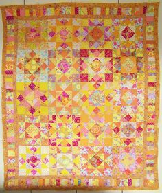 New Orleans Star quilt,  Kaaffe Fassett.        Cape Pincushion: Kaffe Fassett