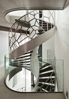 Helical stairs or curved staircase is a graceful form in architecture with it's flowing helix and absent centre column. Check our helical staircase photogallery Modern Architecture House, Amazing Architecture, Interior Architecture, Staircase Architecture, Installation Architecture, Escalier Design, Balustrades, Glass Balustrade, Take The Stairs