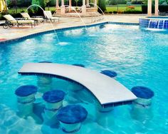 Find out if a swim-up bar is the right option for your pool and get pro tips on designing swim-up bars. Swim-Up Bar Ideas for your Swimming Pool Design Ideas.
