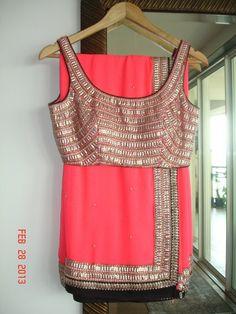 Orange, gold and black saree or sari with blouse