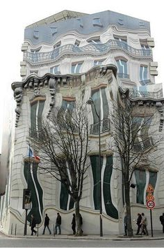 The Hausmannian Building in Paris, France looks like a blurred picture, but is a real building wrapped in an amazing mural by artist John Pugh.