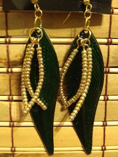 Green metal feather with gold seed bead dangles