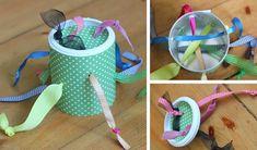 activité bébé 1 an - tirer des rubans avec noeuds dans une boîte