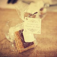 """Adding to the farmland wedding theme, Ariel said, """"At each place setting at the reception we had packages of s'more makings for the guests to enjoy."""" Photo Credit: Bellagala"""