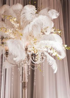 10 Unbelievably Creative Centerpiece Ideas: To heighten the drama, tall arrangements of feathers lend an air of old Hollywood glamour. Photo by Jess Elysse Photography; Floral by A Design Resource