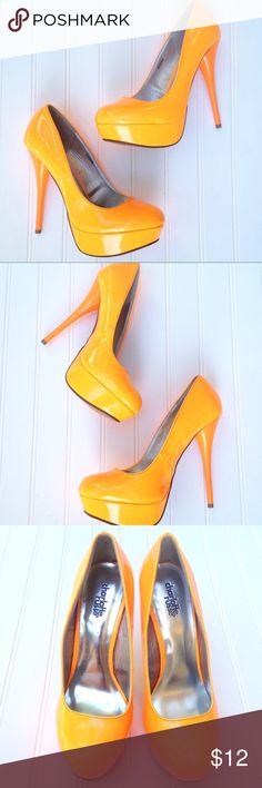 """Neon orange stiletto platform pumps Step into the bright with these dual-tone neon orange platform heels from Charlotte Russe! Day-glo orange upper and darker creamsicle orange heel will release the inner Jem and the Holograms/Rainbow Bright/EDM goddess in you! Size 8. Insole length: 9 3/4"""". Front platform: 1.5"""" Heel height: 5"""" Width at widest point on bottom: 2 3/4"""". Essentially NWOT. Just a bit of marking on bottom sole from demo walking in them. Feel free to ask questions or make an…"""