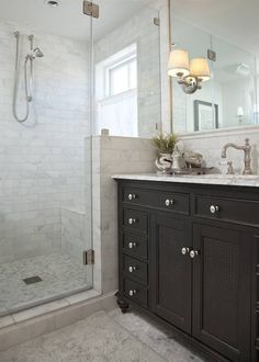 bathrooms - Restoration Hardware French Empire Extra-Wide Single Vanity Sink Restoration Hardware Lugarno Sconce ebony stained bathroom cabinet carrara marble hexagon tiles shower floor marble tiles shower surround backsplash frameless glass shower