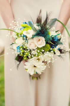 stunning blue, white, and green, peacock themed DIY bouquet from a DIY, small-budget, personalized Maryland wedding. Images by Raven Shutley, You Are Raven Photography.