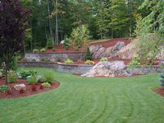 Wow. I'd love to have such majestic boulders in my backyard. It's like having the mountains right there! Landscape design by Groundhog Landscaping in New Hampshire.