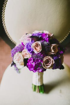 LOVE this bouquet and it's mix. It has enough lighter shades of purple mixed in that I would almost suggest doing this for the bride and bridesmaid bouquets. Only, have the brooches added for the bride to separate her out. Purple And Silver Wedding, Purple Wedding Flowers, Bridesmaid Flowers, Bride Bouquets, Flower Bouquet Wedding, Floral Wedding, Wedding Colors, Wedding Ideas, Wedding Stuff