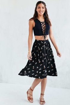 A full and flowery skirt you have to twirl in.   24 Midi Skirts That Are Perfect For Every Occasion