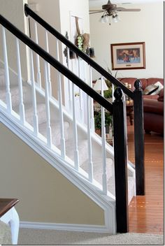 Painted spindles, stained banister & post.