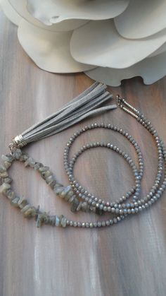 This necklace is very elegant! Its muted tones look particularly nice with grey or pastel coloured clothes.  I have made it with beautiful iridescent labradorite chips, gorgeous grey faceted glass rondelles that are wonderfully sparkly, a handmade faux suede tassel and tiny silver Miyuki seed beads. It closes with a stainless steel lobster clasp. I have a similar one in black made with onyx gemstone chips. See it here…