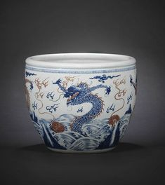A rare massive blue and copper-red 'four-dragons' fish bowl, Kangxi