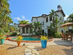 """613 W Venice Ave, Venice, FL 34285 —  One of the only walled 1926 Historic Estates llocated on the Isalnd of Venice.This unique,rare treasure is 2 blocks to the famous Venice Beach as well as downtown.a well preserved updated home with a state of the art kitchen with European """"Poggen Pohl"""" cabinets,Sub Zero refrigerator,Viking gas stove,wine cooler and Bosch dishwasher.Originalbrick flooring.Formal Dining room with fireplace,crown molding,spectacular chandelier and original tile…"""