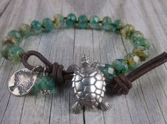Sea turtle and tree of life knotted bracelet by WynnesWhimsies, $31.00 I love the leather& button clasp.  I've gotta work on my technique.