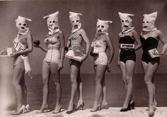 Bizarre beauty contest - Beach beauty pageant contestants with scary bags on their heads. Date unknown.