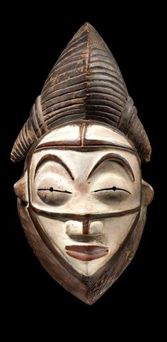 Mask of the Punu People of Gabon, Africa. There were and still are many tribes in Gabon. Their traditions are still practiced to this day.