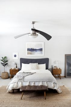 Modern bohemian bedroom in natural shades of blue