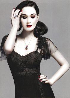 Dita Von Teese. Red lops. Pale skin. Black dress. FAR more attractive than leathery tan skin.