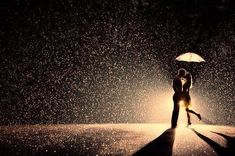 kiss in the rain...I hate rain, but I would be willing to stand in it to get a shot like this with Jer